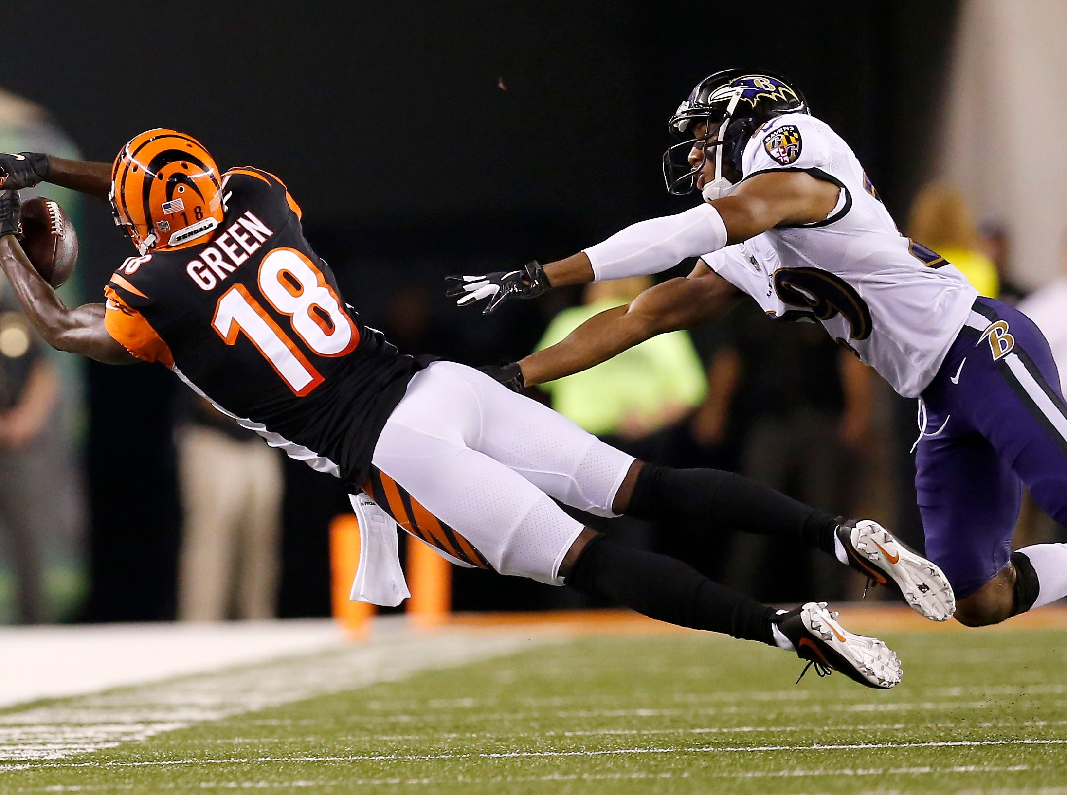 Cincinnati Bengals wide receiver A.J. Green (18) stretches for a pass but lands incomplete in the second quarter of the NFL Week 2 game between the Cincinnati Bengals and the Baltimore Ravens at Paul Brown Stadium in downtown Cincinnati on Thursday, Sept. 13, 2018. The Bengals led 28-14 at halftime.