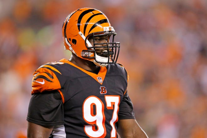 Cincinnati Bengals defensive tackle Geno Atkins (97) returns to the sideline after a Ravens drive in the second quarter of the NFL Week 2 game between the Cincinnati Bengals and the Baltimore Ravens at Paul Brown Stadium in downtown Cincinnati on Thursday, Sept. 13, 2018. The Bengals led 28-14 at halftime.