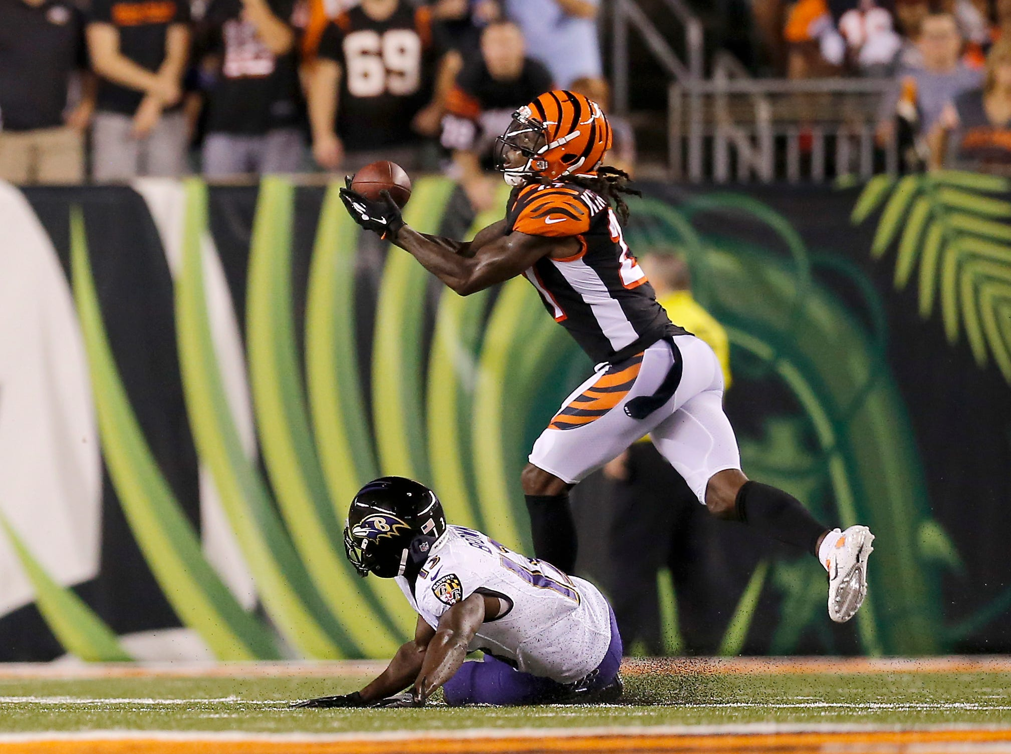 Cincinnati Bengals defensive back Dre Kirkpatrick (27) nearly intercepts a deep pass intended for Baltimore Ravens wide receiver John Brown (13) in the second quarter of the NFL Week 2 game between the Cincinnati Bengals and the Baltimore Ravens at Paul Brown Stadium in downtown Cincinnati on Thursday, Sept. 13, 2018. The Bengals led 28-14 at halftime.