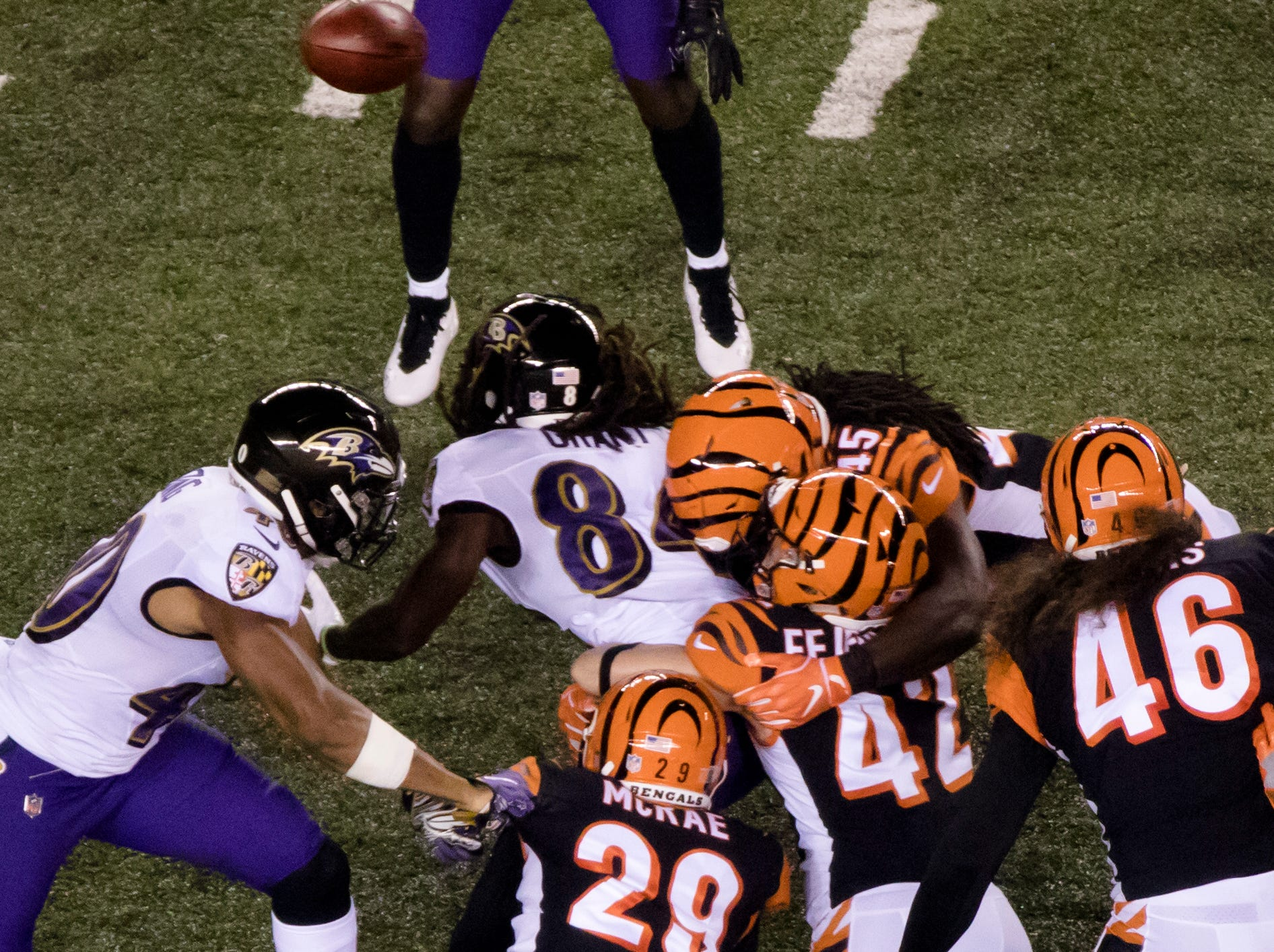 Cincinnati Bengals running back Joe Mixon (28) and Cincinnati Bengals safety Clayton Fejedelem (42) force Baltimore Ravens wide receiver Janarion Grant (84) to fumble during the Week 2 NFL game between the Cincinnati Bengals and the Baltimore Ravens, Thursday, Sept. 13, 2018, at Paul Brown Stadium in Cincinnati.