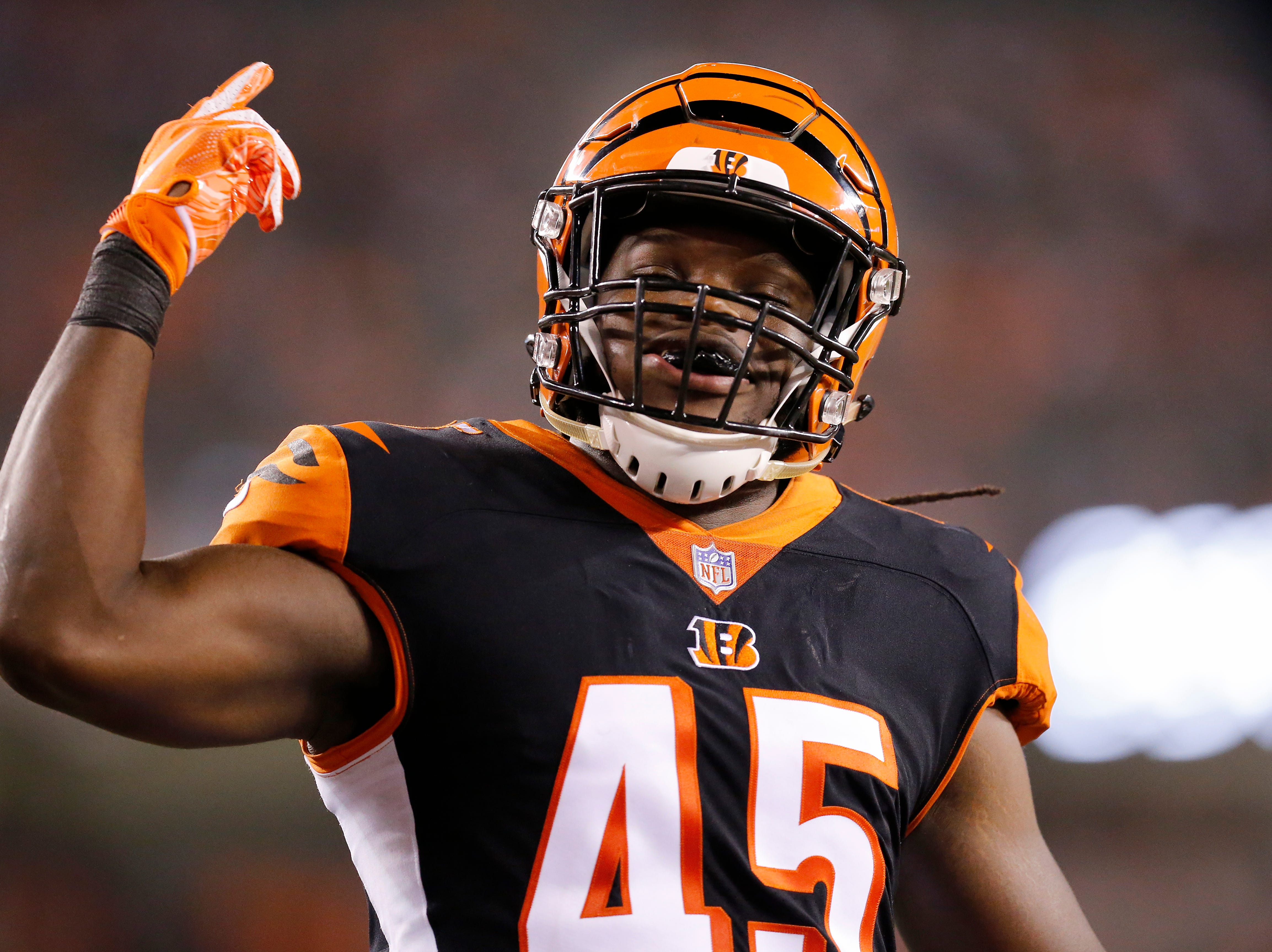 Cincinnati Bengals linebacker Malik Jefferson (45) pumps up the fans after a kick off in the fourth quarter of the NFL Week 2 game between the Cincinnati Bengals and the Baltimore Ravens at Paul Brown Stadium in downtown Cincinnati on Thursday, Sept. 13, 2018. The Bengals improved to 2-0 on the season with a 34-23 win over the Ravens.