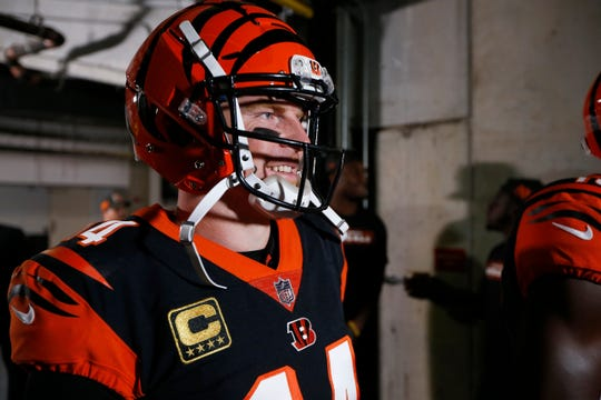 Cincinnati Bengals quarterback Andy Dalton (14) waits for his introduction before the first quarter of the NFL Week 2 game between the Cincinnati Bengals and the Baltimore Ravens at Paul Brown Stadium in downtown Cincinnati on Thursday, Sept. 13, 2018. The Bengals led 28-14 at halftime.