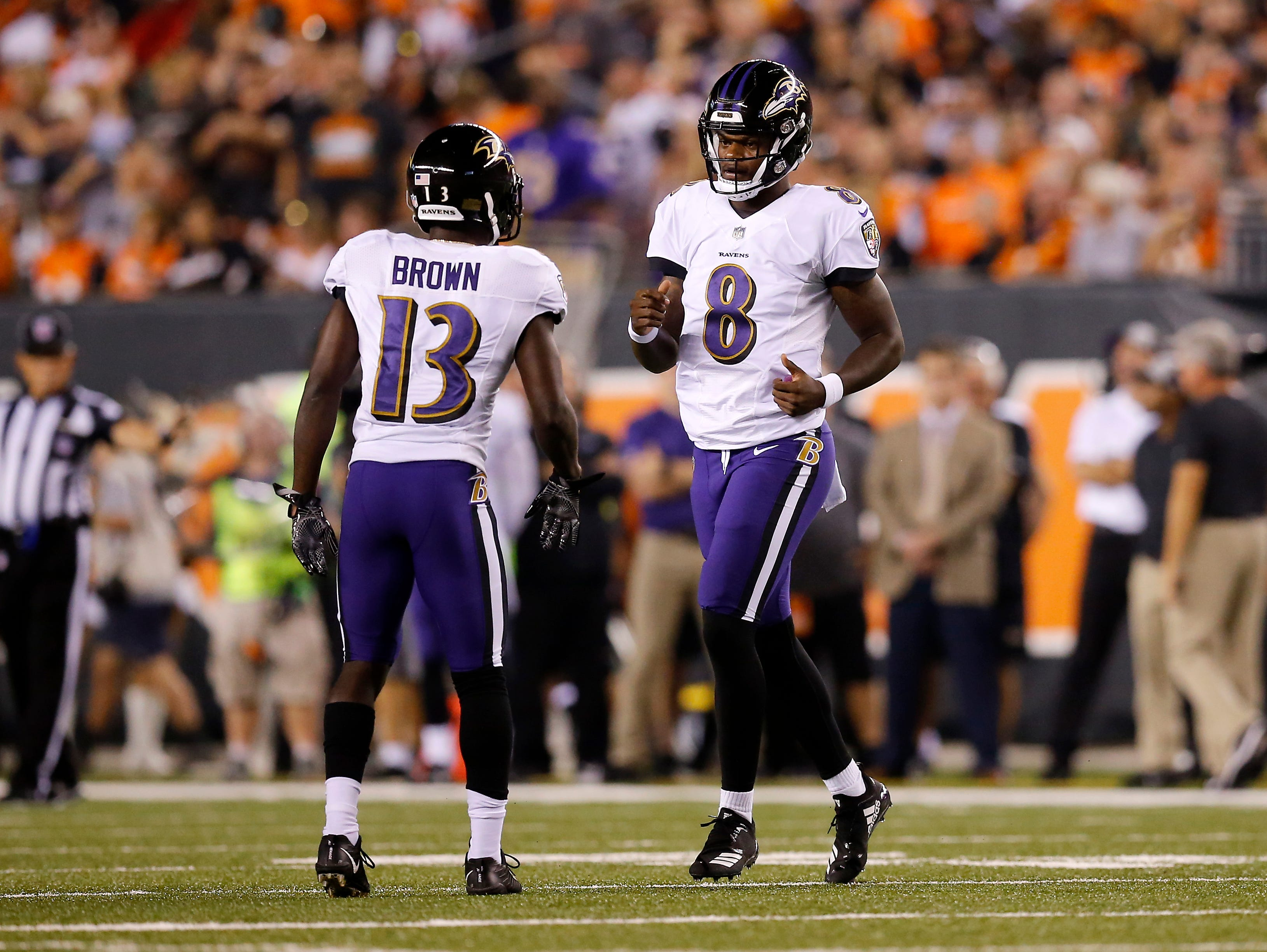 Baltimore Ravens quarterback Lamar Jackson (8) comes in for a play in the second quarter of the NFL Week 2 game between the Cincinnati Bengals and the Baltimore Ravens at Paul Brown Stadium in downtown Cincinnati on Thursday, Sept. 13, 2018. The Bengals led 28-14 at halftime.