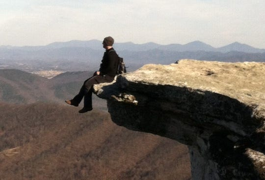 "Scott Loring Sanders ""Surviving Jersey"" is a book of essays about his memories of growing up in the Garden State and they shaped him. Here is shown perched atop McAfee Knob in Virginia."