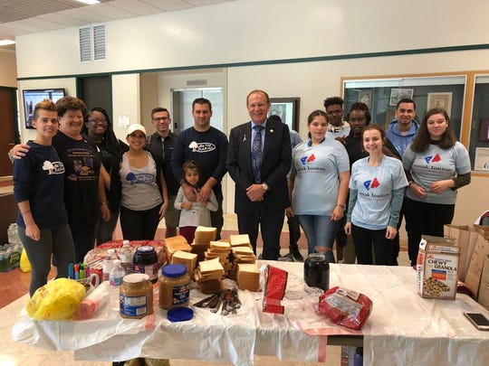 Former State Sen. Raymond Lesniak, with volunteers from the Lesniak Institute for American Leadership and Be the Change NJ, make peanut butter and jelly sandwiches at Kean University for distribution to the homeless in New York City.
