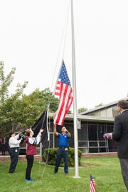 American flag that flew over Ground Zero is raised at Kean University as part of the September 11 Remembrance ceremony.