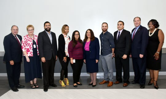 Union County Freeholder Chairman Sergio Granados and Freeholders Bruce H. Bergen and Angel G. Estrada congratulate Joann Harper of Community Access Unlimited (CAU), Aisha Arroyo of UCA, Cathy Waters of the Urban League of Union County, Michael A. Buckley of the Elizabeth Housing Authority and Edwin Pacheco of CAU as among the first 44 graduates of the 2017-2018 Union County Leadership Fellows Institute during a ceremony at CAU in Elizabeth. They were joined by Union County Department of Human Services Director Debbie-Ann Anderson and Assistant Director Karen Dinsmore.
