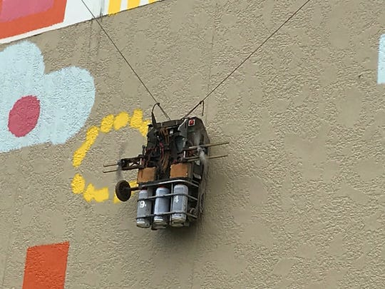 """Last week, """"Albert"""" - aroboticgraffiti artist, created by SprayPrinter,painted a mural at 15 Station Place in Metuchen."""