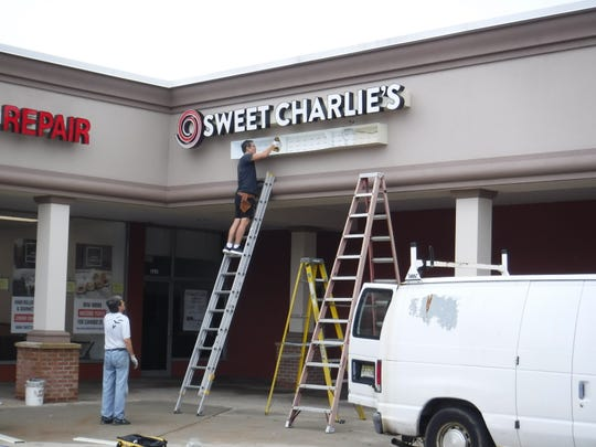 "Outdoor signage for the new ""Sweet Charlie's"" ice cream shop on Route 516 in Old Bridge was being installed on Thursday, Sept. 13."