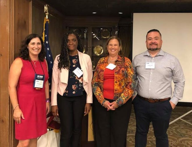 (Left to right) Deborah Augustus, president of ISM-NJ and new members Courtney Sackey of Beumer Corp., Jeanine Brady of Sims Metal Mgt., and George Jimenez of NBA.