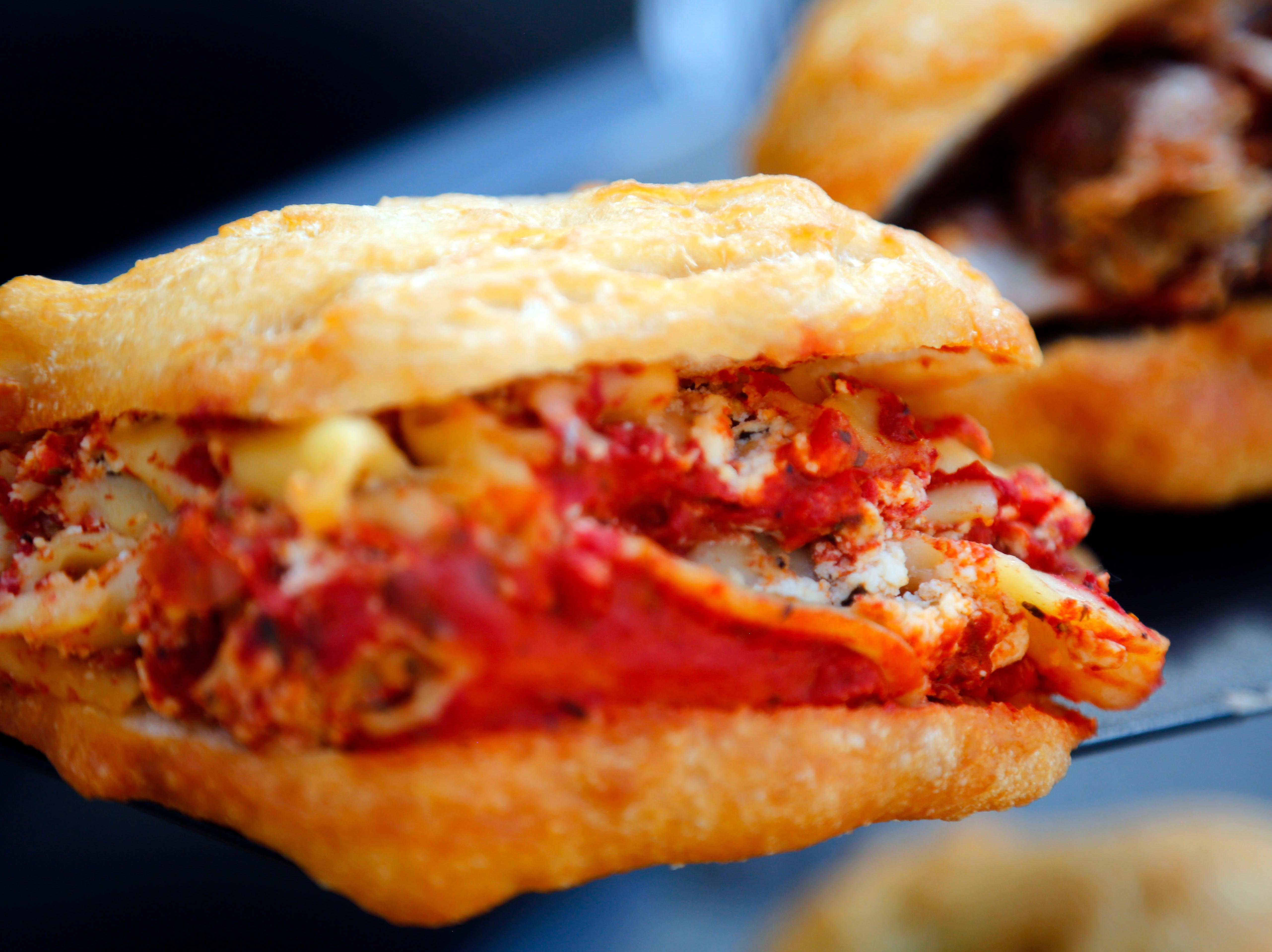 A lasagna sandwich at the Formaro's Stuffed booth at the World Food and Music Festival in Des Moines Sept. 14, 2018.