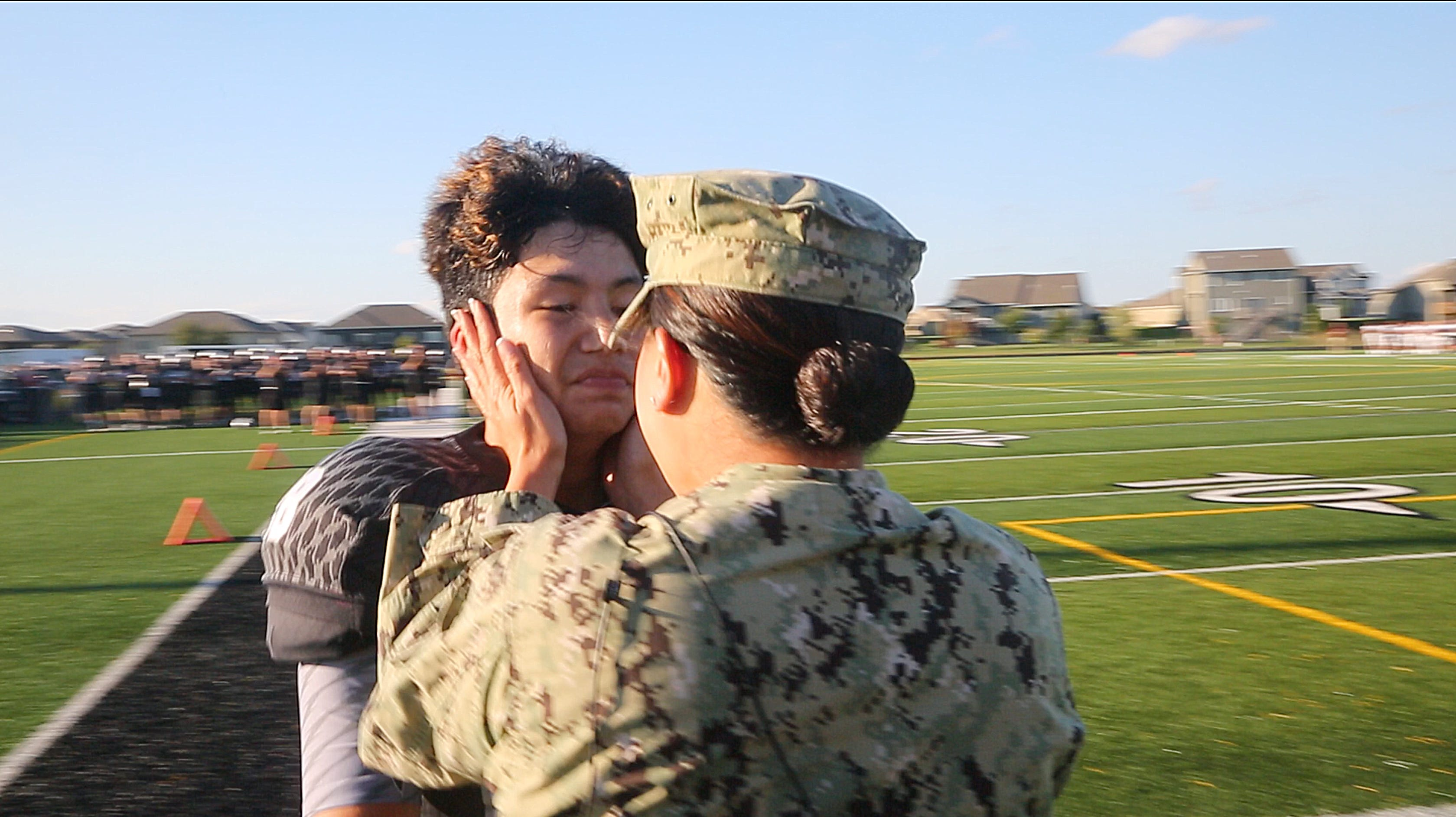 Navy mom surprises son at Ankeny Centennial football game