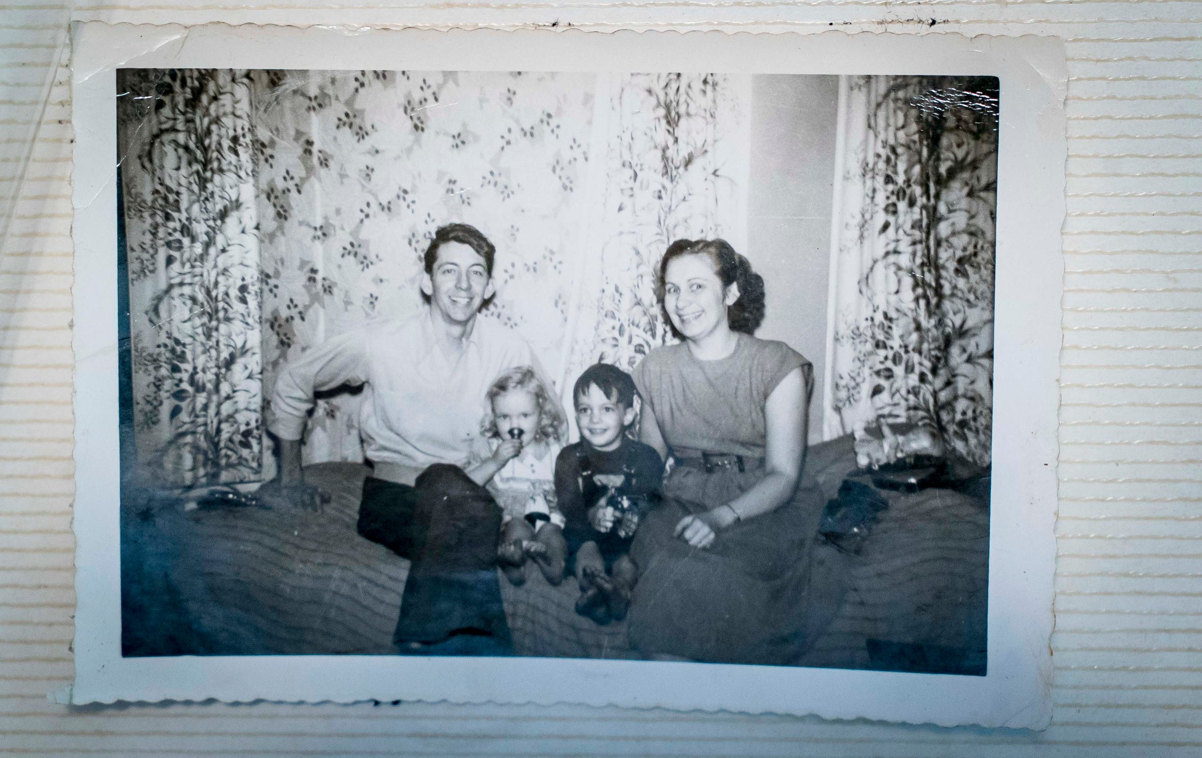 "Undated photo of A.W. ""Dub"" Barron, left, with unknown woman and children from Barron's half-brother Bobby Sexton's family album."