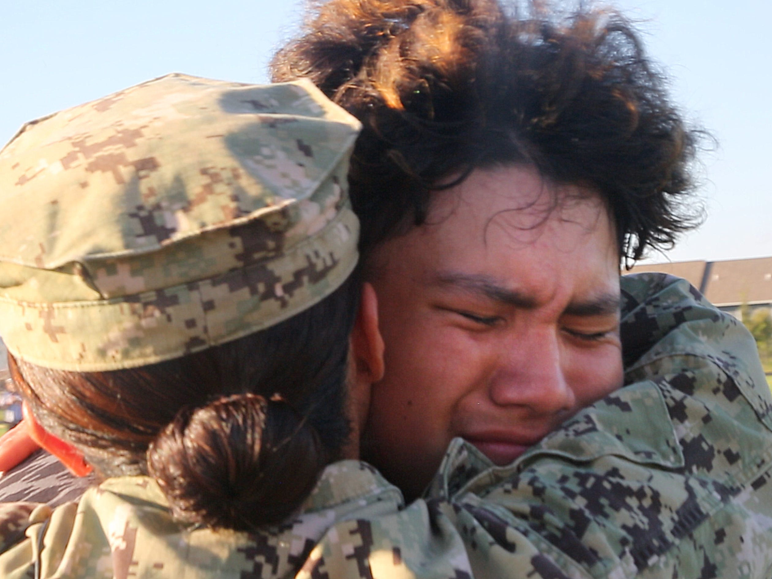 Navy Gunner Mate 1st Class Expeditionary Warfare Specialist Diem Carpenter returns home after 10 months to surprise her son Gabriel Arrendondo, a member of Ankeny Centennial's sophomore football team at his game Sept. 14, 2018.