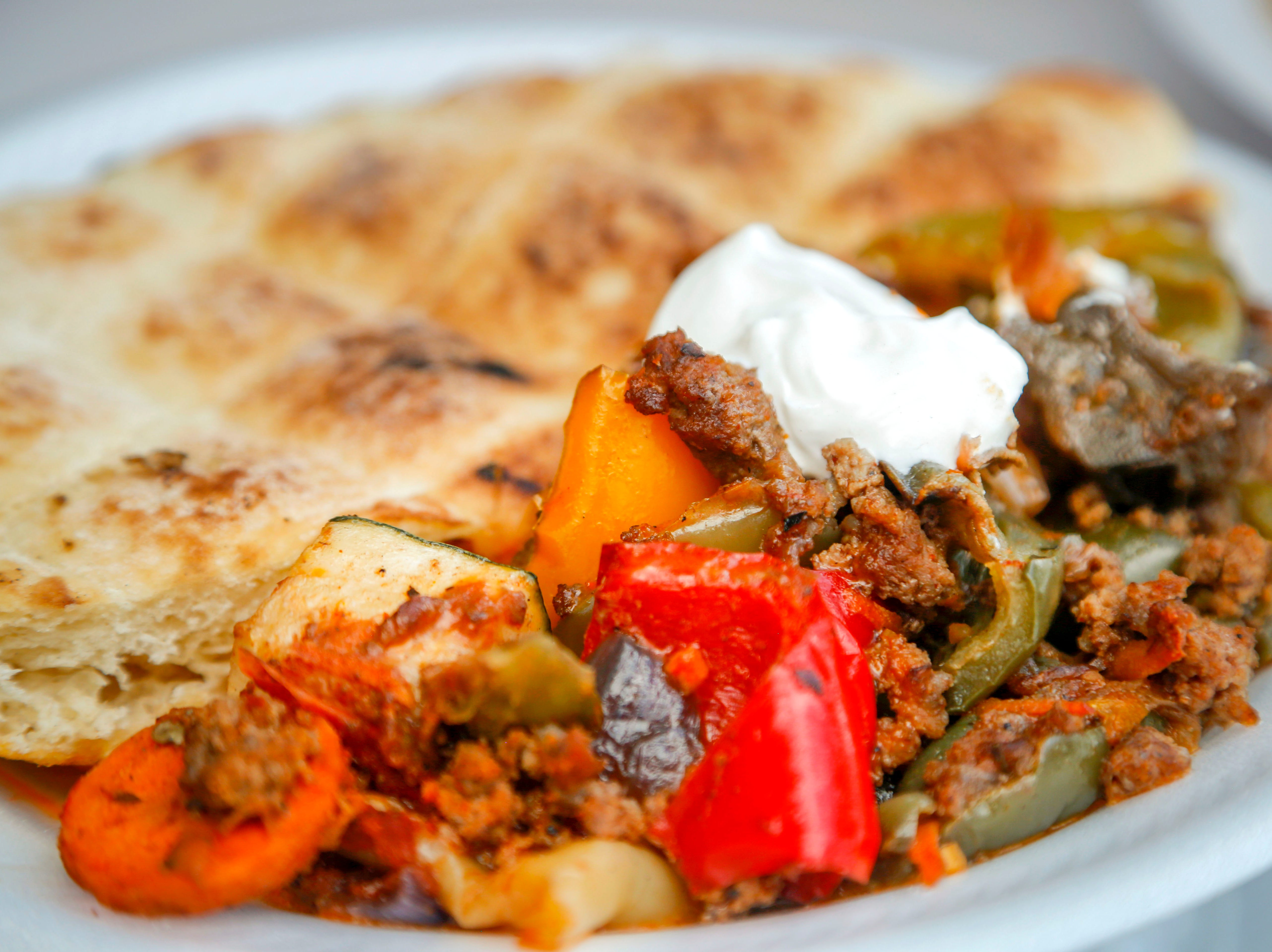 Sataras with pita bread from Papillon Bosnian Food at the World Food and Music Festival in Des Moines Sept. 14, 2018.