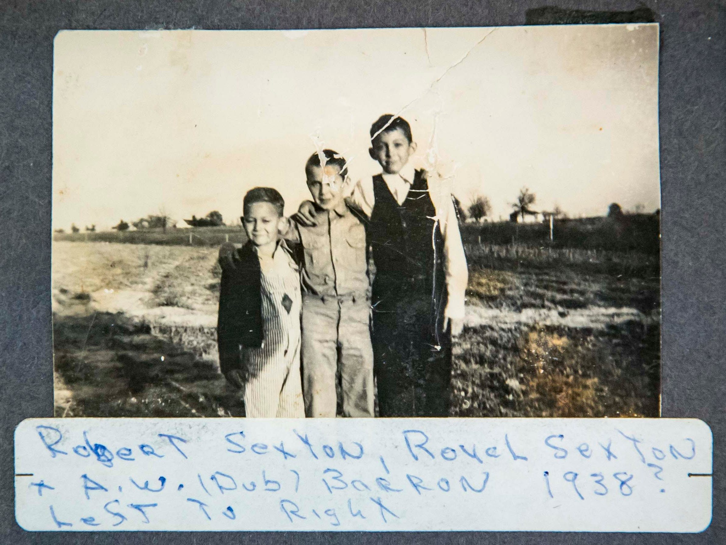 "Robert Sexton, left, Royal Sexton, and half brother A.W. ""Dub"" Barron, right, 1938."