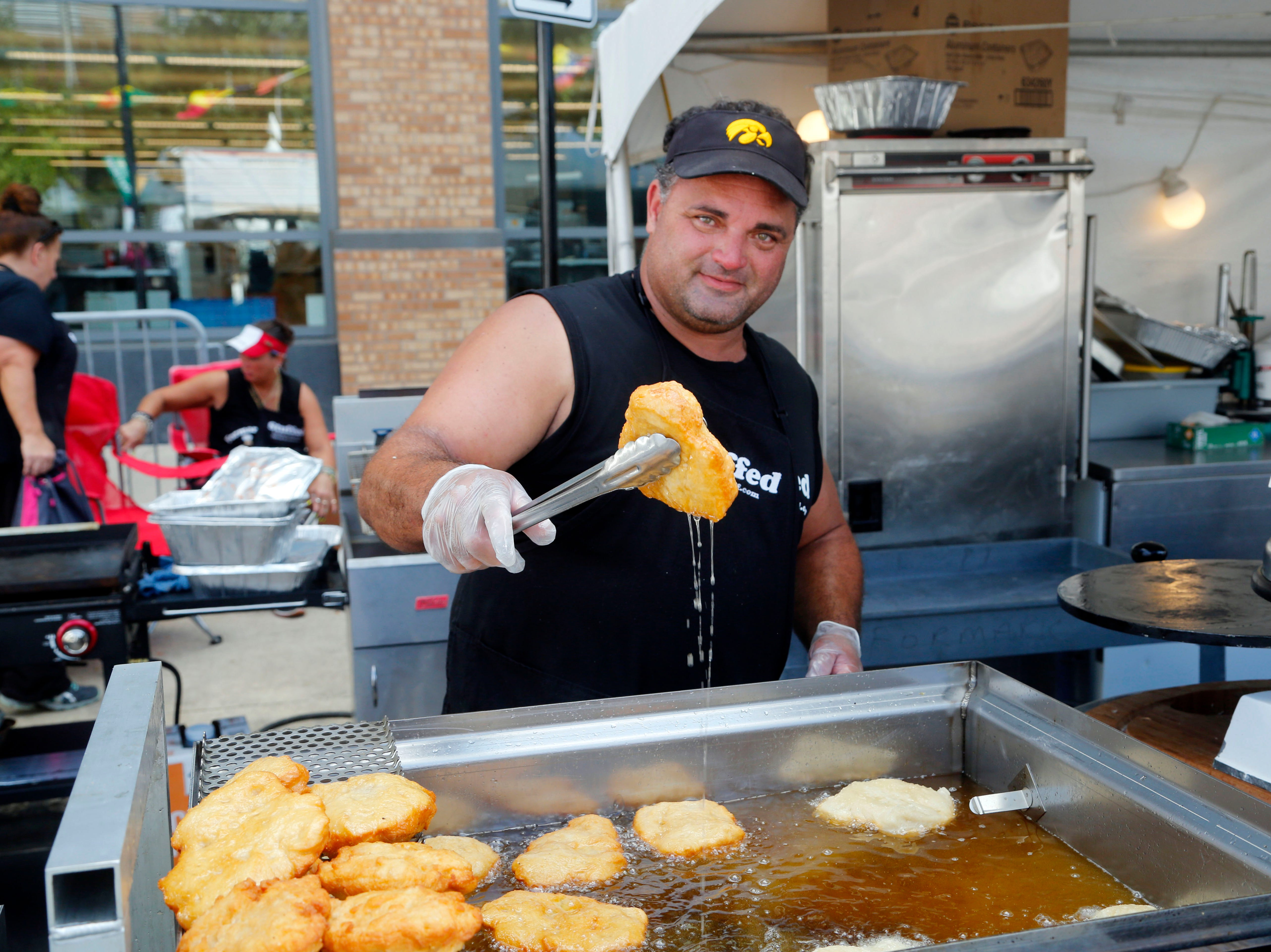 Scott Formaro fries bread for his sandwiches at the Formaro's Stuffed booth at the World Food and Music Festival in Des Moines Sept. 14, 2018.
