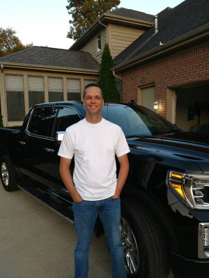 Kurt Wagner of White Lake stands with the 2019 GMC Denali pickup he bought Aug. 10.