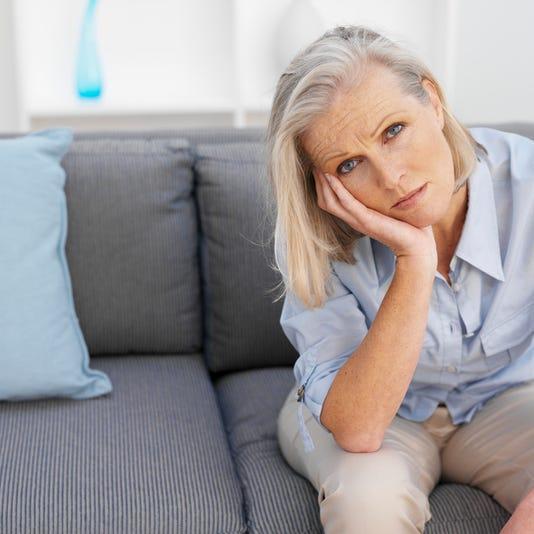 Senior Woman Sitting On Sofa Elevated View Portrait