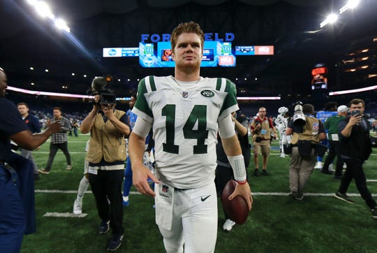 New York Jets quarterback Sam Darnold walks off the field after crushing the Detroit Lions, 48-17, in his NFL debut at Ford Field, Sept. 10, 2018 in Detroit.