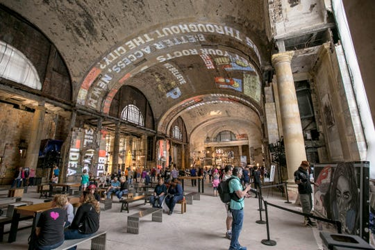 People wander around inside Michigan Central Station in Detroit during an open house put on by Ford Motor Company on Friday, June 22, 2018.