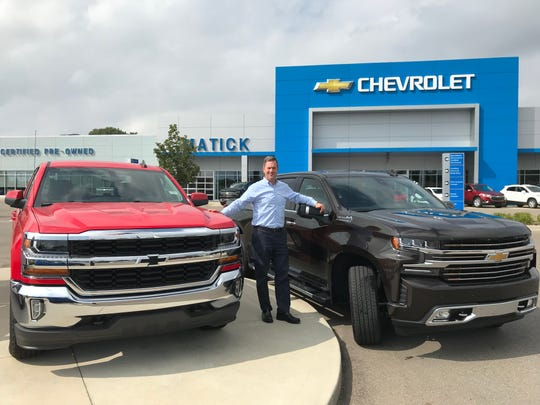 Dealer Operator Paul Zimmermann stands with two of the Chevrolet Silverado pickups he has in stock at George Matick Chevrolet in Redford.