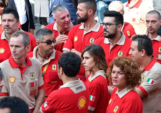 Ferrari workers attend a commemorative Mass for late CEO Sergio Marchionne in Turin's cathedral, Italy, Friday, Sept. 14, 2018.