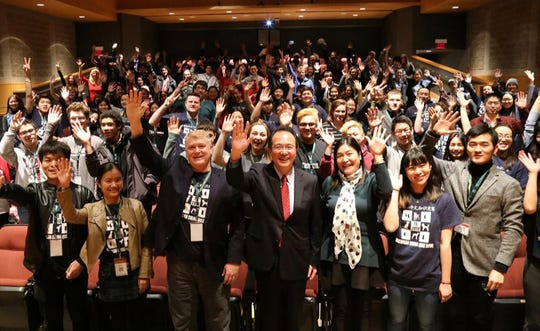Hong Lei, center, Chinese Consulate General in Chicago, at a Chinese language competition of high school students from Detroit hosted by Confucius Institute at Wayne State University.