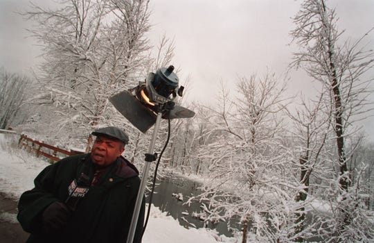 WJBK-TV (Channel 2) reporter Al Allen reports on the snowy weather on Feb. 26, 2002 in the Edinborough neighborhood in Novi.