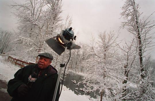 WJBK-TV (Channel 2) reporter Al Allen reports on the snowy weather on Feb. 26, 2002 in the Edinborough neighborhood in Novi.