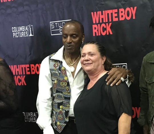 "Johnny Curry and Dawn Scott (Richard  Wershe Jr.'s sister) pose for photos before the screening in Novi of ""White Boy Rick."" They're portrayed in the movie by Jonathan Majors and Bel Powley."