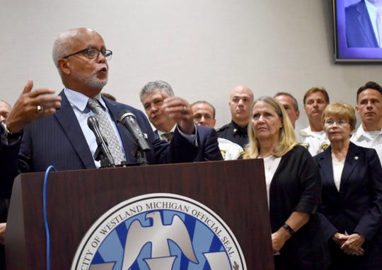 """Flanked by first responders and health officials, Wayne County Executive Warren Evans talks about a """"Rescue Recovery"""" pilot program, created to effectively treat opioid addiction, decrease overdose deaths, and help municipalities battle the opioid epidemic, during a press conference at Westland City Hall Friday."""