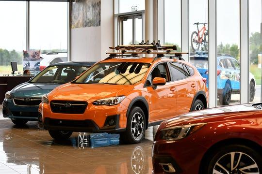 An orange 2019 Subaru Crosstrek sits on the showroom floor at Sellers Subaru in Macomb. Subaru has seen a lot of sales growth in its crossover models.