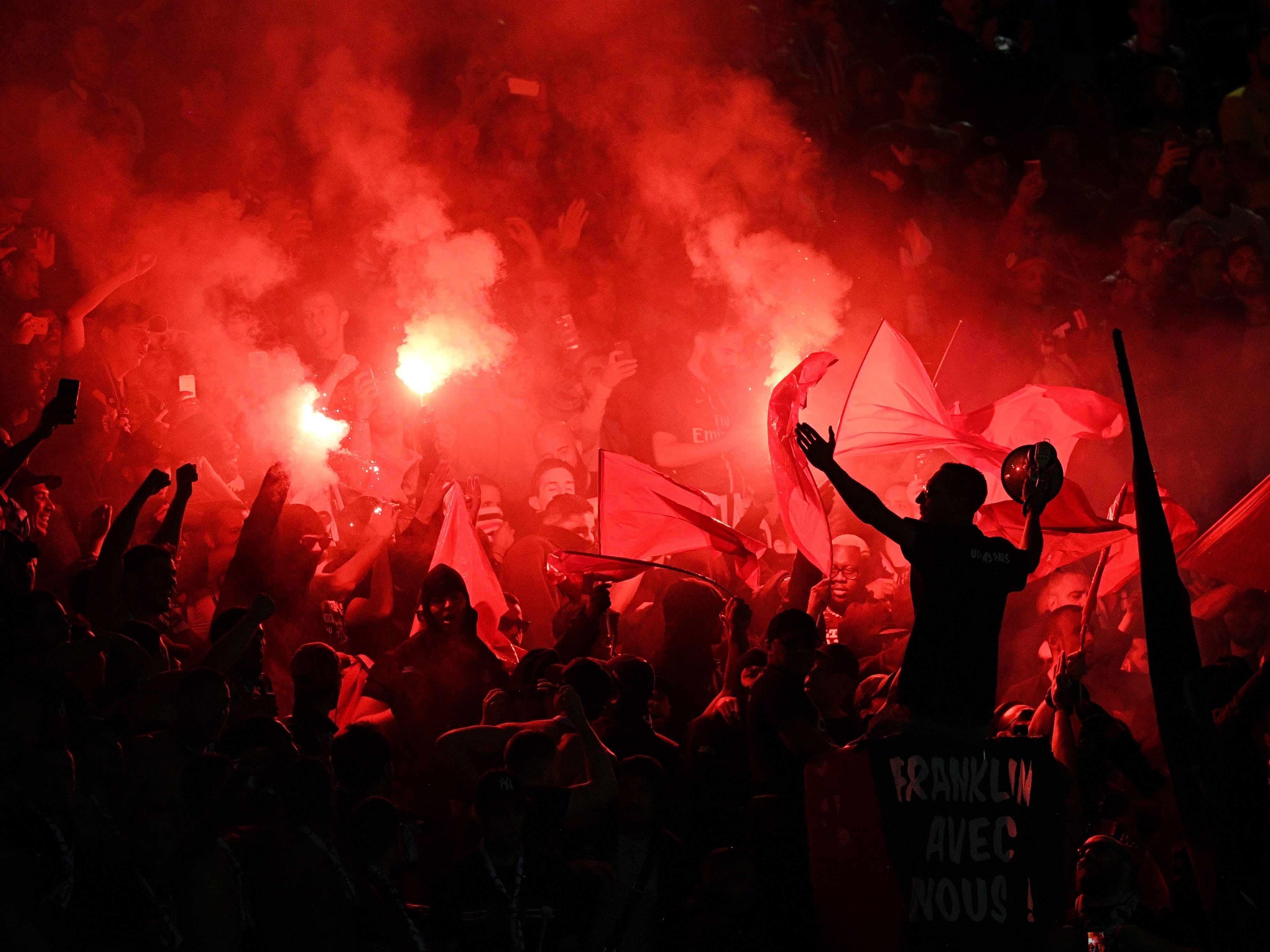 Paris Saint-Germain's supporters cheer and burn flares  during the French L1 football match between Paris Saint-Germain (PSG) and Saint-Etienne (ASSE) at the Parc des Princes stadium in Paris on September 14, 2018.