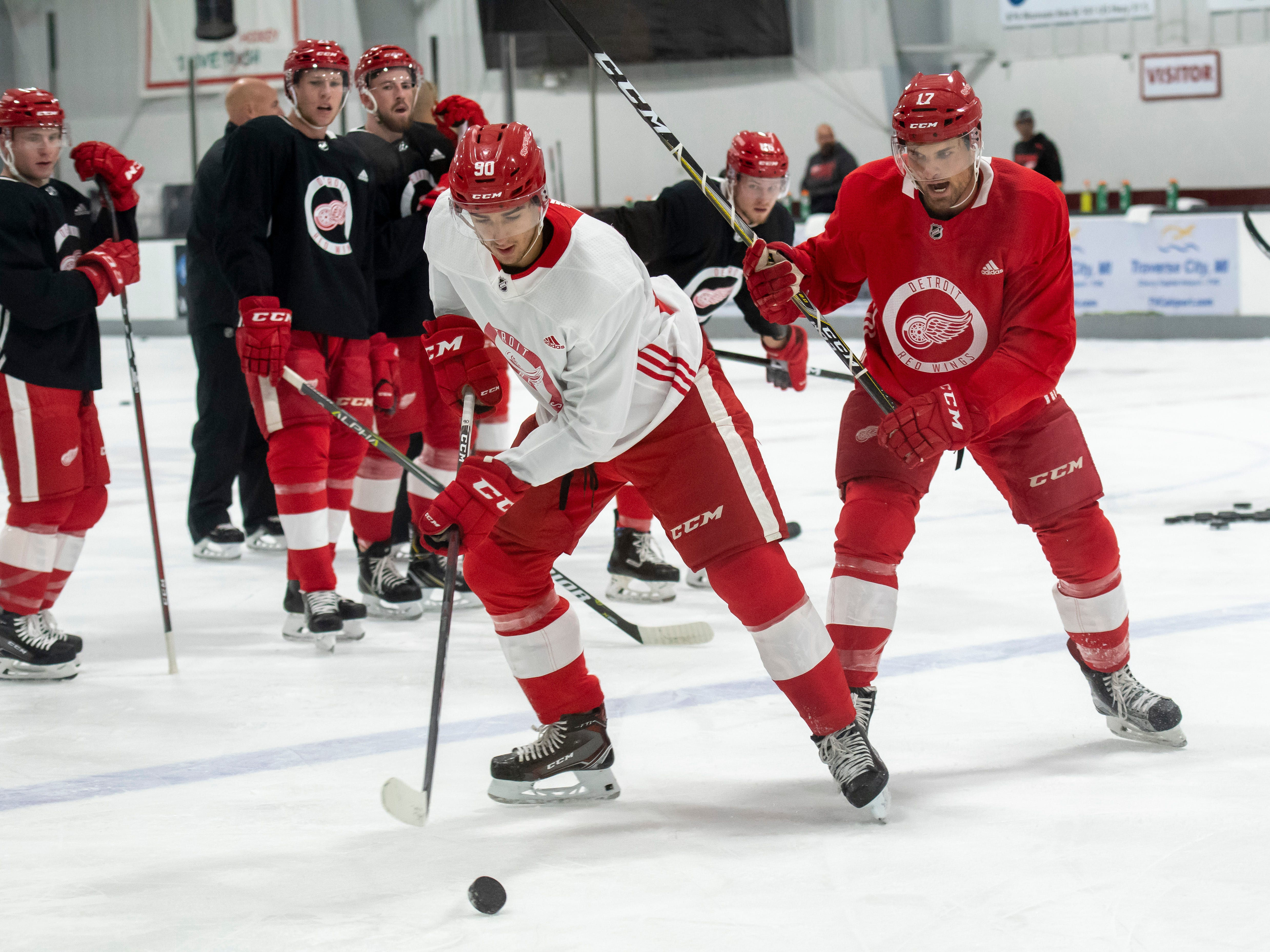 Detroit forward Joe Veleno, left, and forward Colin Campbell battle for the puck during practice.