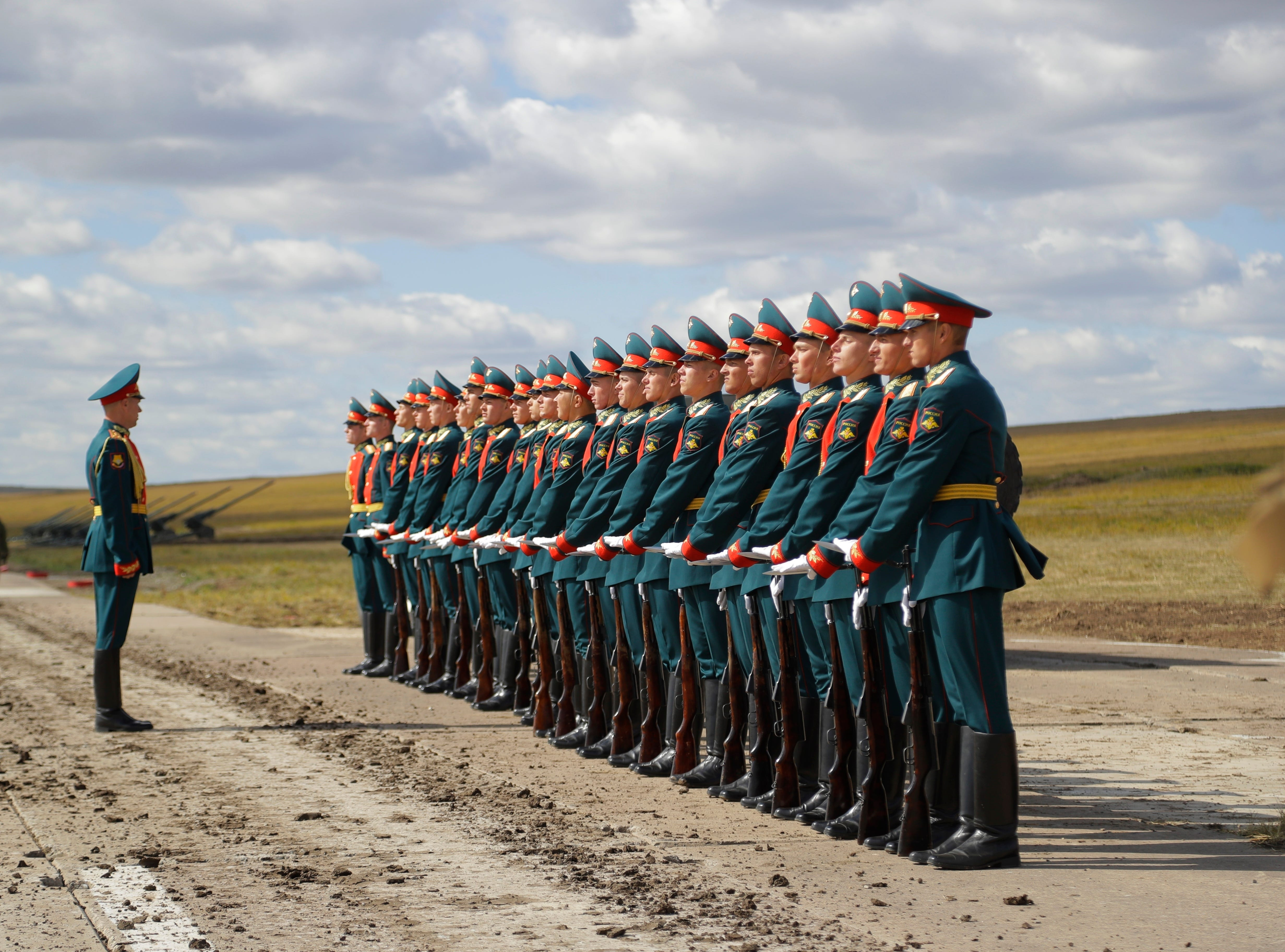 "Russian honors guard prepares to take a part in a parade prior to a military exercises on training ground ""Tsugol"", about 250 kilometers (156 miles ) south-east of the city of Chita during Vostok 2018 in Eastern Siberia, Russia, Thursday, Sept. 13, 2018. The weeklong Vostok (East) 2018 maneuvers launched Tuesday span vast expanses of Siberia and the Far East, the Arctic and the Pacific Oceans. They involve nearly 300,000 Russian troops along with 1,000 Russian aircraft and 36,000 tanks and other combat vehicles."