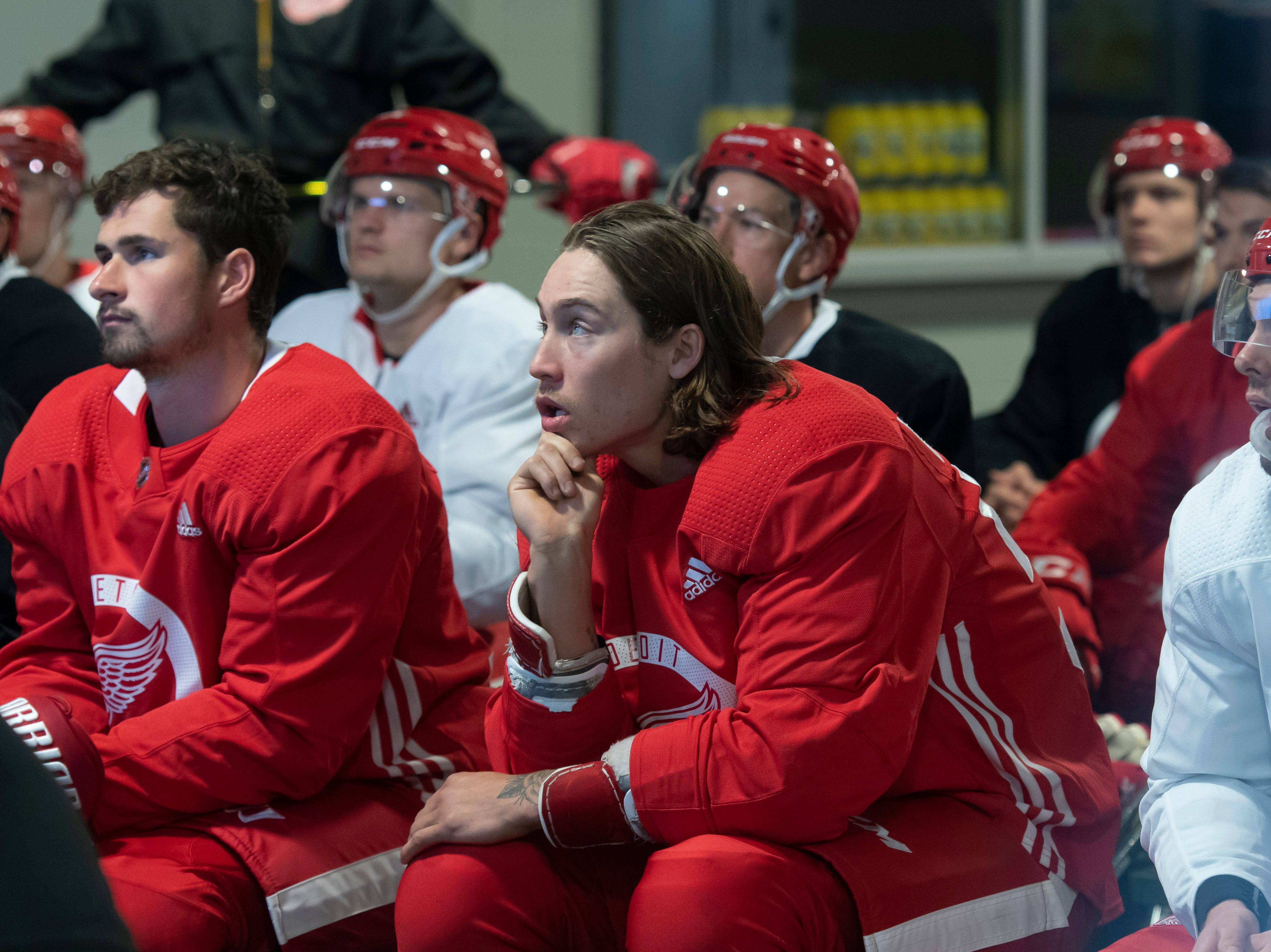 Detroit forward Tyler Bertuzzi, center, and the rest of the team watch video before the start of practice.            Photos are of the Detroit Red Wings during training camp at Centre Ice Arena, in Traverse City, September 14, 2018.  (David Guralnick / The Detroit News)