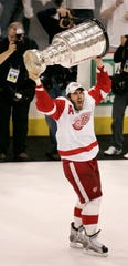 Playoff MVP Henrik Zetterberg lifts the 2008 Stanley Cup after the final buzzer of a 3-2 Cup-clinching victory over the Pittsburgh Penguins. The Red Wings won the series 4-2.