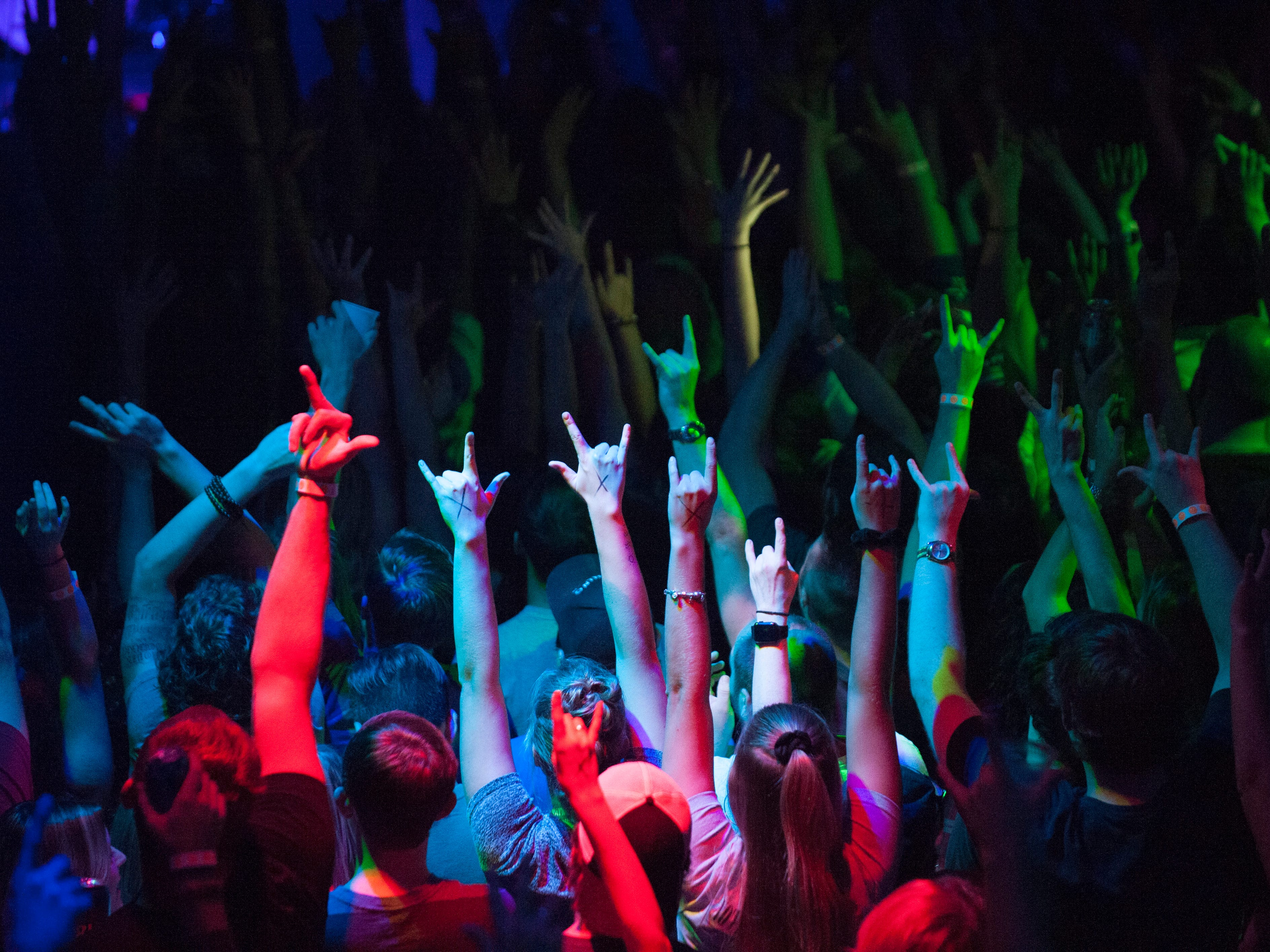 Fans throw their hands in the air at the conclusion of Grandson's performace at St. Andrews Hall in Detroit.
