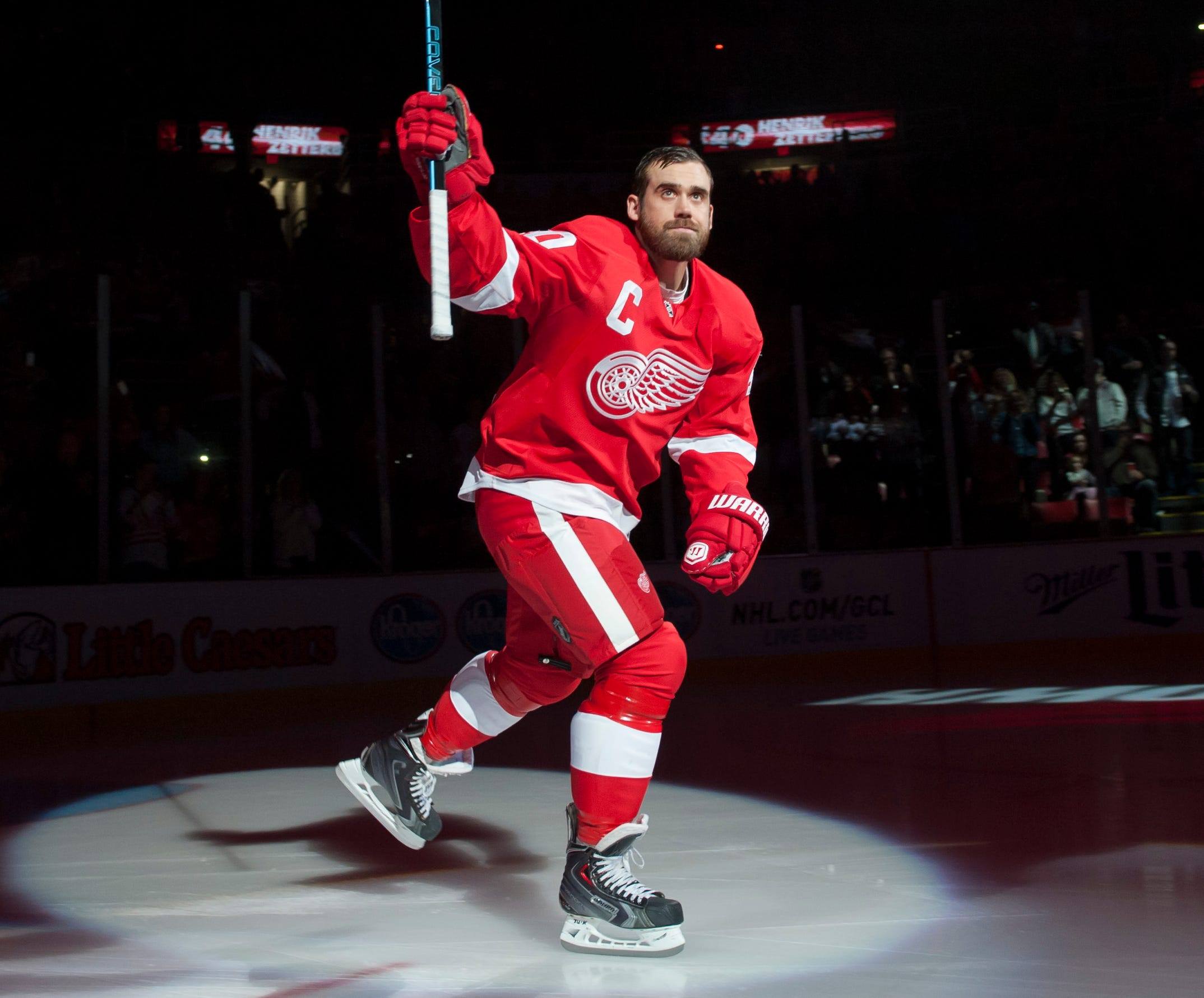 Detroit Red Wings left wing Henrik Zetterberg skates onto the ice for pre-game introductions before the start a game against the Boston Bruins at Joe Louis Arena on Oct. 9, 2014.