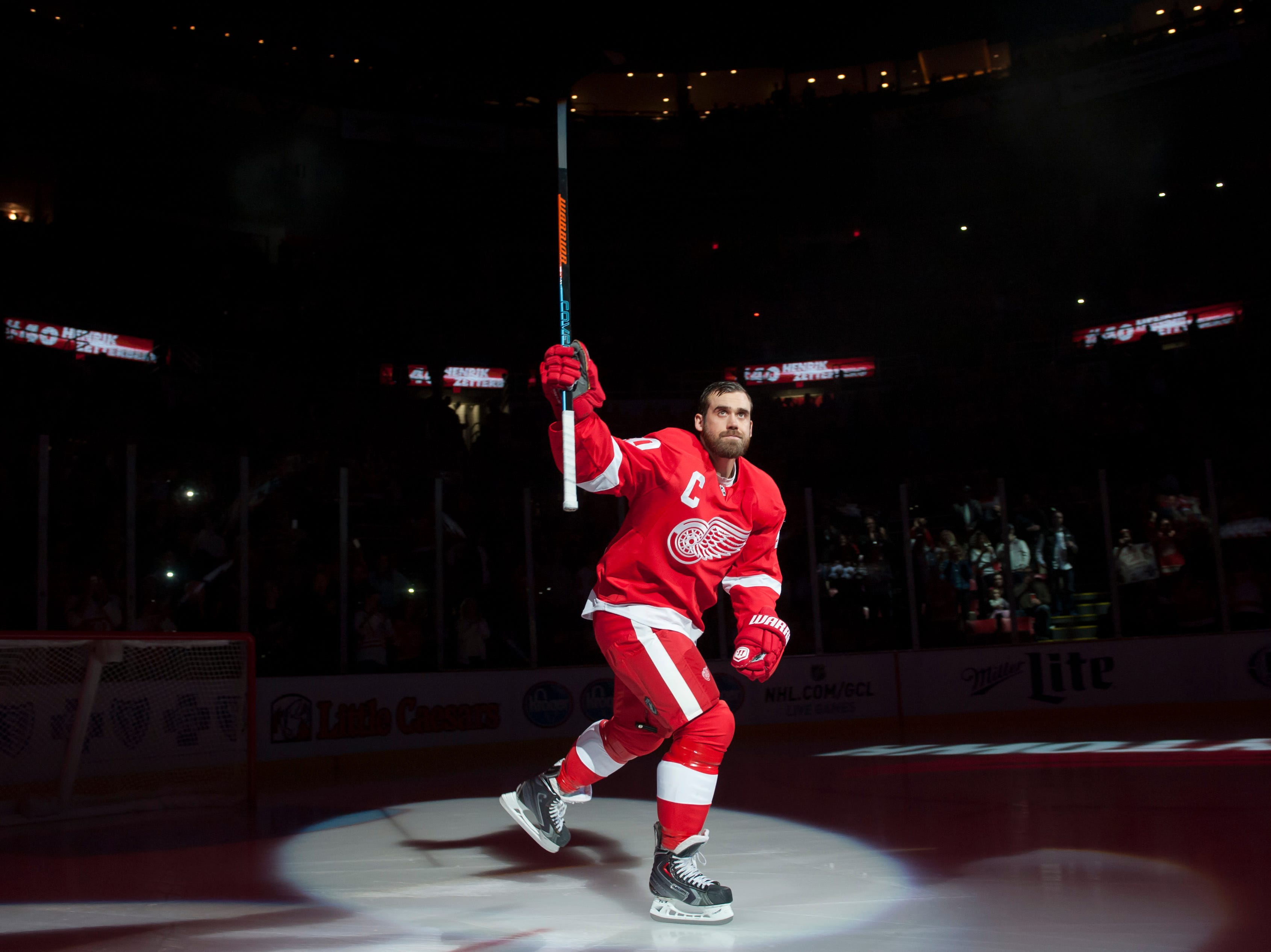 Detroit Red Wings left wing Henrik Zetterberg skates onto the ice for pre-game introductions before the start a game against the Boston Bruins at Joe Louis Arena, in Detroit, October 9, 2014.