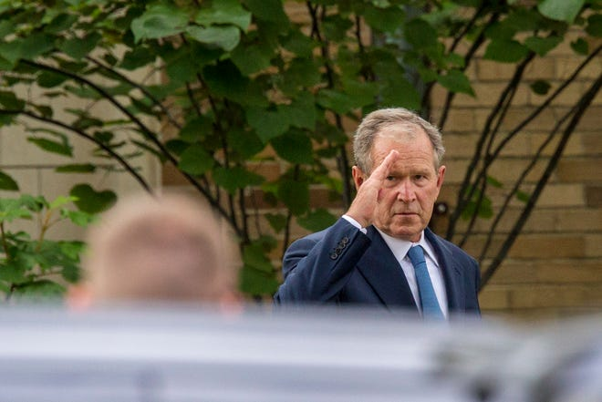 Former President George W. Bush leaves after speaking at the memorial service for Rich DeVos at La Grave Christian Reformed Church in Grand Rapids, Mich., on Thursday, Sept. 13, 2018.