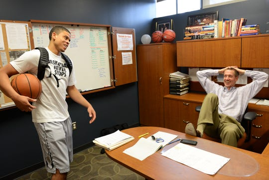 Jay Smith, right, sits in his office in 2014 during his time at Detroit Mercy, where he helped coach Juwan Howard's son, Juwan Jr., for three seasons.