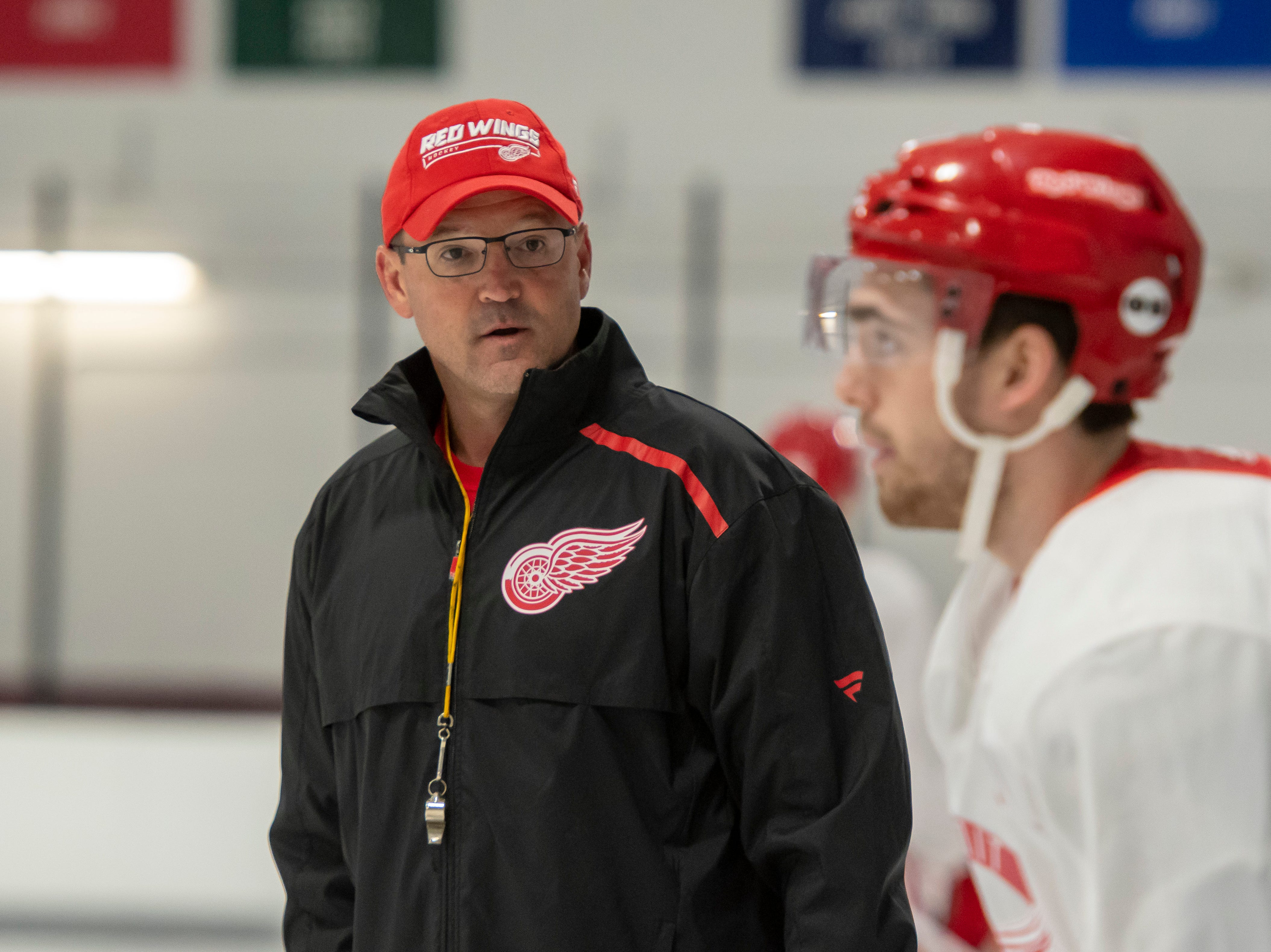 Assistant coach Dan Bylsma keeps his eye on the players during practice.
