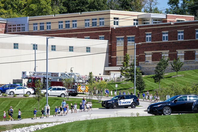 Students and faculty are evacuated from St. Mary's Springs Academy Friday, September 14, after a gas leak was reported to Fond du Lac Fire/Rescue.