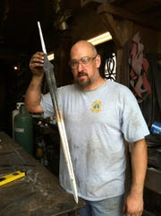"Mike Deibert displays his katana that won the final round of Wednesday's ""Forged in Fire"" episode."
