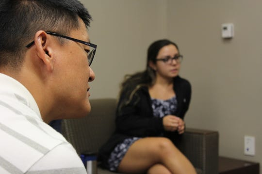 Having difficulty interacting with native English speakers at FSU, Dongjin Ou (left) feels he can express himself through the ECC.
