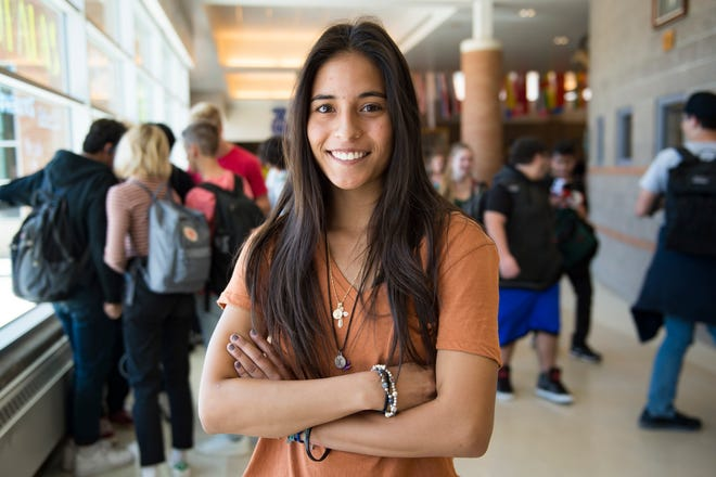 Brenda Herrera Santos poses for a photo in the halls of Poudre High School on Friday, September 14, 2018. The high school senior works to mentor younger students at her school.