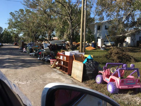 The Henry family lost almost everything because of Hurricane Irma's flooding. The family's belongings, including a Power Wheels Barbie Jeep, sat out by the curb for trash pickup.