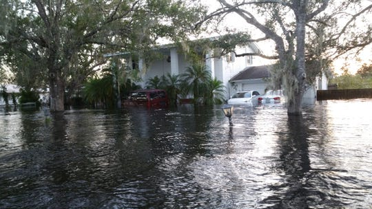 The water at Ben Henry's house was so high it covered the driveway's gateposts.